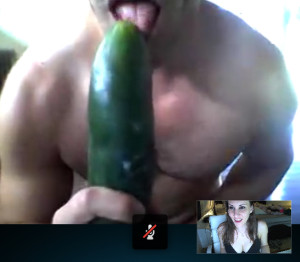 sucking on a cucumber like a cock